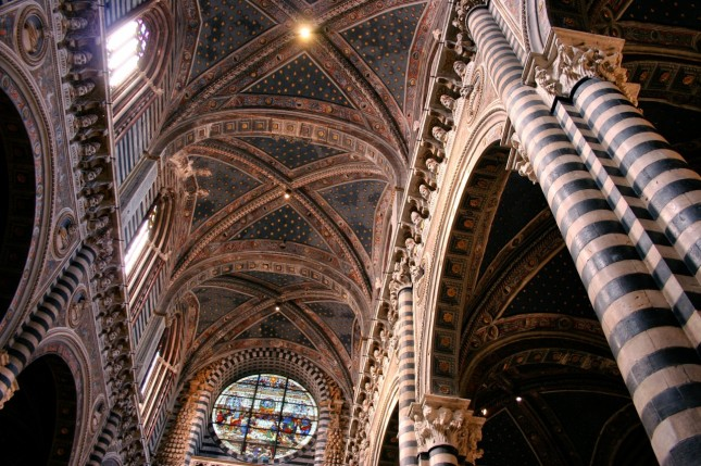 Above the nave are busts of popes and emperors