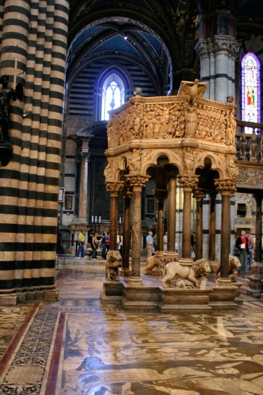 Nicola Pisano's pulpit sculpted from Carraran marble