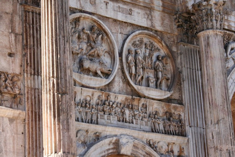 The artistic style of the roundels from Hadrian's time (first third of the second century) markedly differs from the rectangular panel below (4th century)