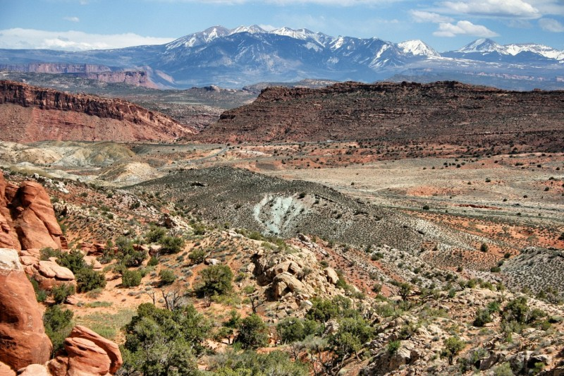 Salt domes in the valley push up under the valley floor. The La Sal Mountains are in the background.
