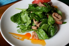 Spinach salad, calamari, white nectarine, toasted coconut dressing