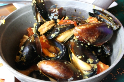 Steamed Cortez Island mussels, chorizo, mesquite smoked tomato broth, grilled foccacia
