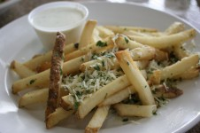 Fries with shaved Parmesan cheese and truffle oil