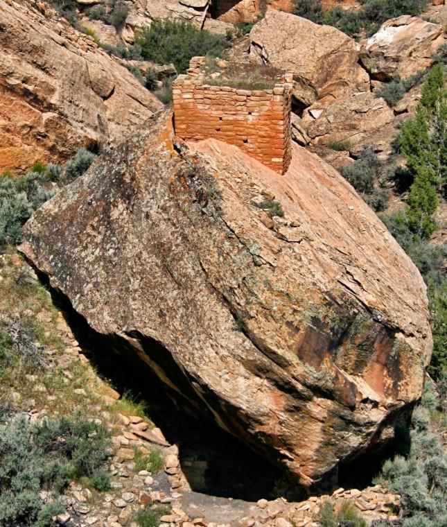Structure built on top of fallen boulder