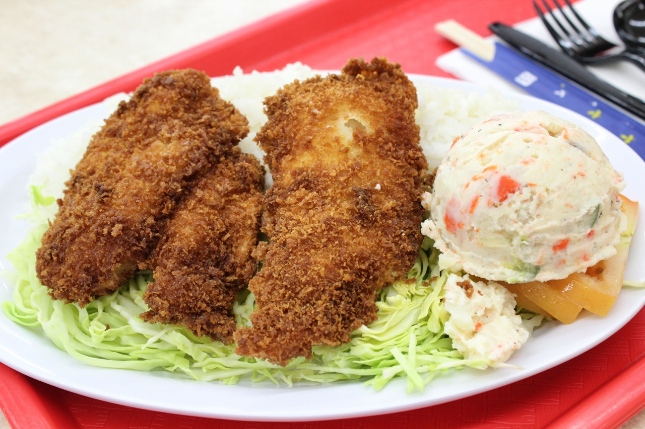 Fried fish combination with rice and potato salad