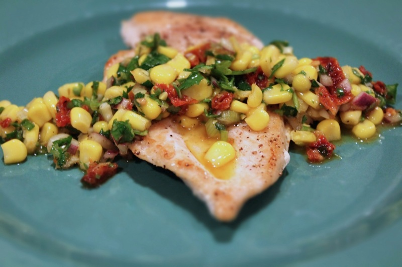 Pan-fried chicken breasts with corn salsa