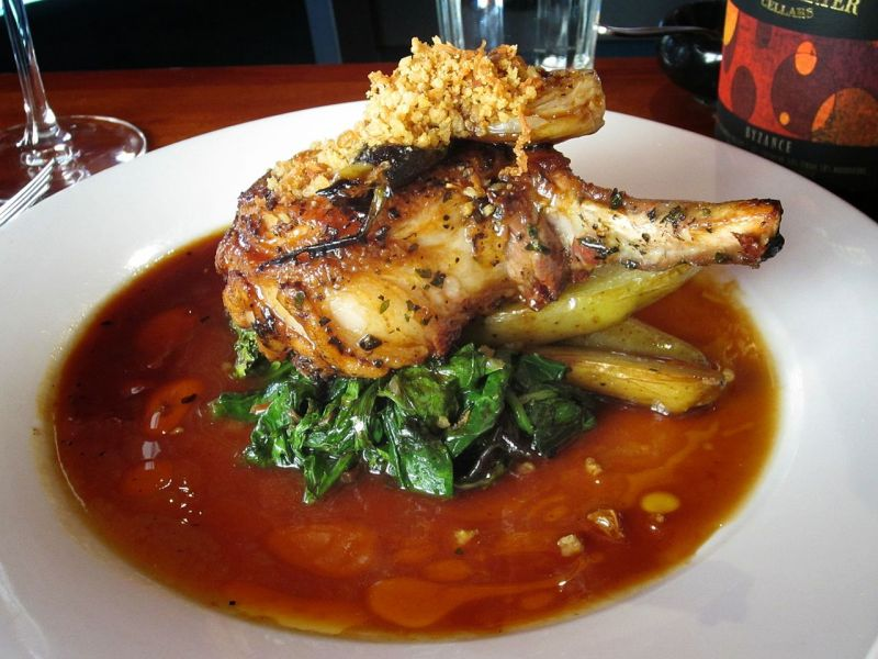 Tails & Trotters Pork Chop with Braised Kale and Fingerling Potatoes