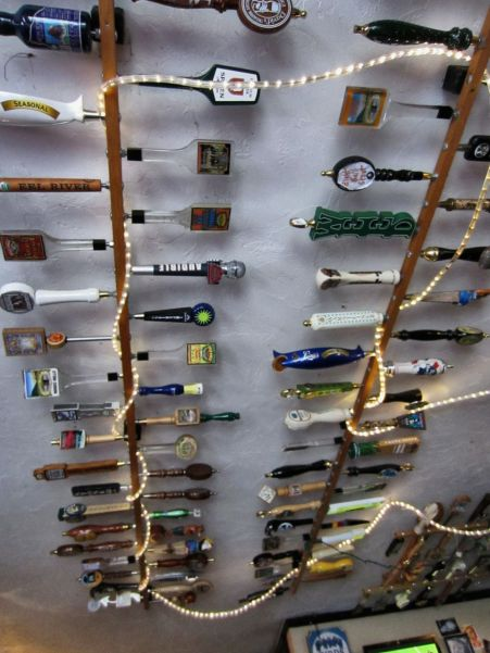 Draft beer handles mounted on the ceiling