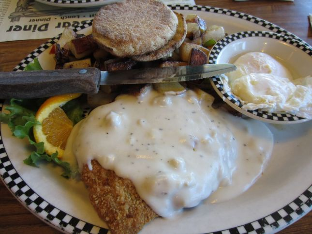 Chicken fried steak, country potatoes and poached eggs
