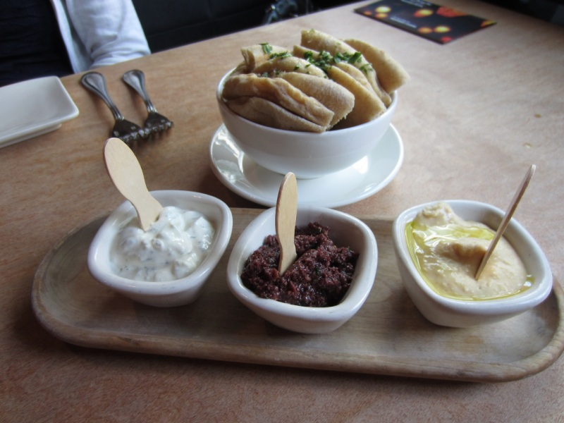 Tzatziki, olive-fig and fava spreads with pita