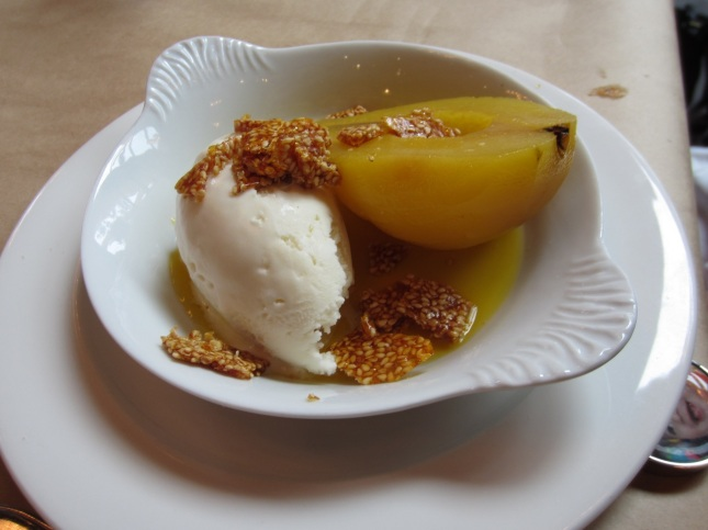 Saffron citrus poached pear with honey ice cream & sesame seeds