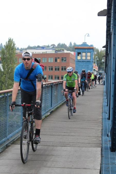 Bicyclists crossing after closing the bridge