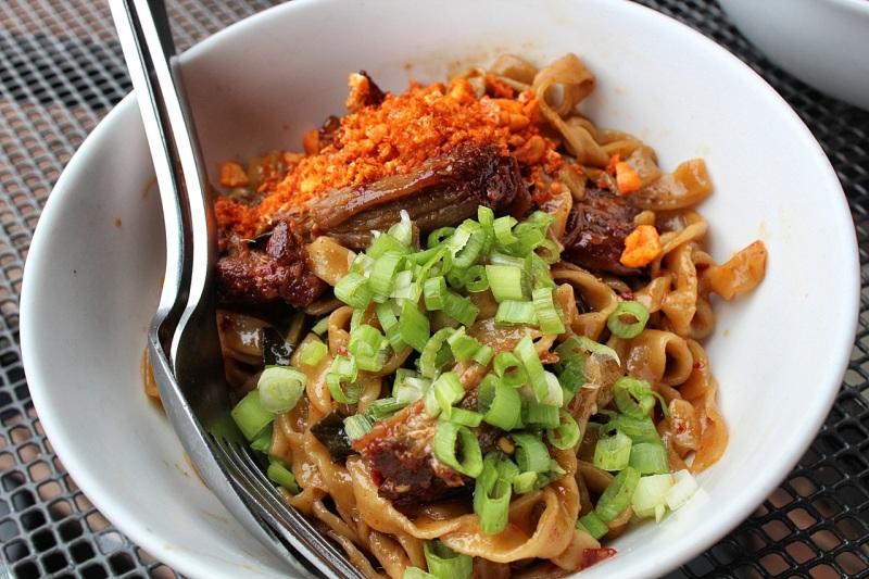 Dandan noodles, smoked pulled pork, peanuts