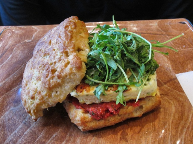 Biscuit with truffled frittata, tomato caper relish and arugula