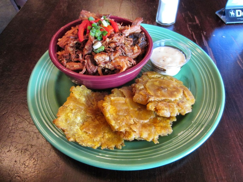 Pernil bowl with tostones and mojito