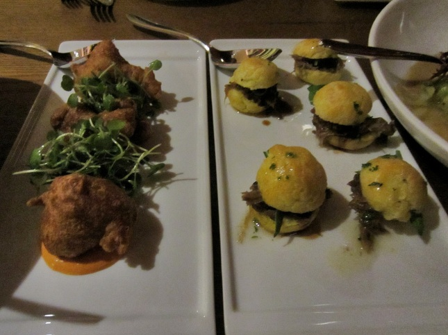 Crab beignets and duck confit sliders