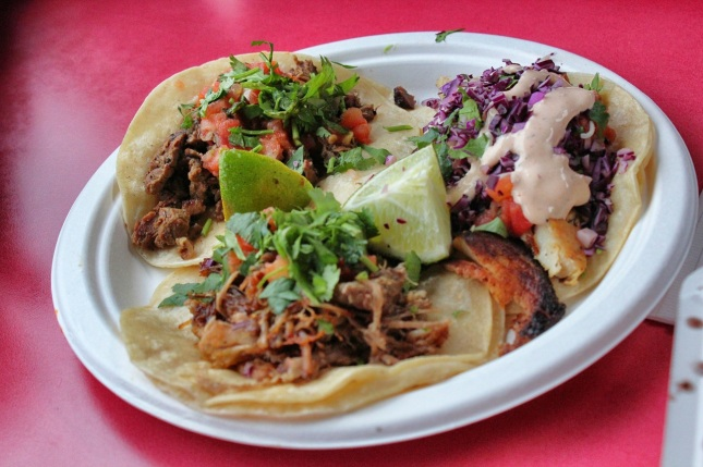 (Clockwise from upper left) carne asada, fish and carnitas tacos
