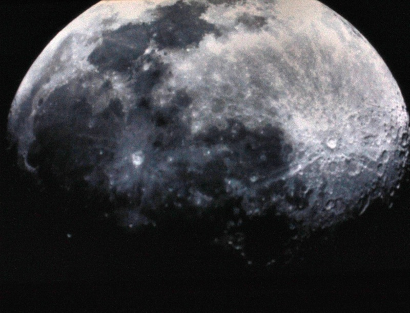 The moon projected onto a blank surface from a telescope (Onizuka Center)