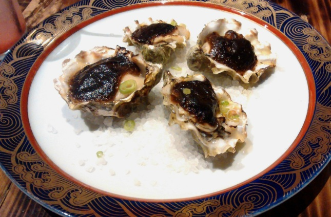 Oysters with fermented black garlic