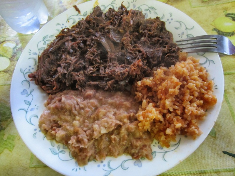 Combination plate of birria de chivo