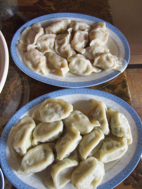 Cabbage pork dumplings (top), leek and fish dumplings (bottom)