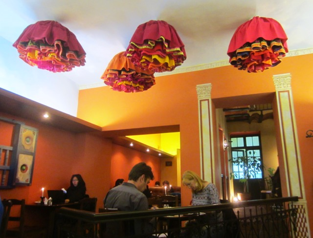 Light shades on the ceiling of Café Banais were made to look like cholita skirts